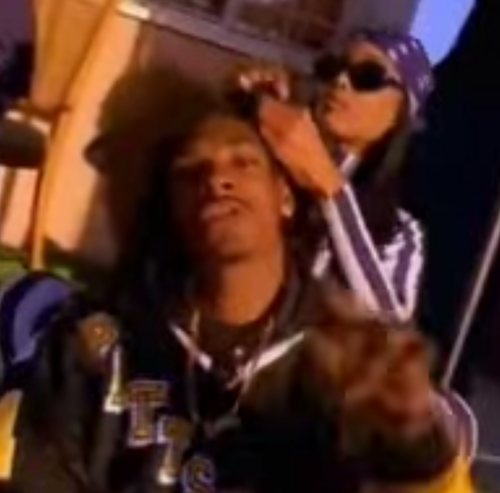 Snoop Doggy Dogg getting his hair braided