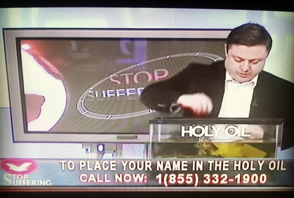 Pastor putting names in Holy Oil